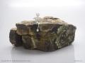14 - Figurine seated on rock (Sylvie).jpg