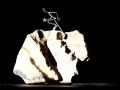 Figurine running up rock